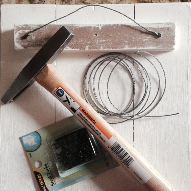 How to hang a picture with nails and wire